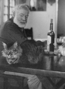 Hemingway and a small tiger. Hemingway started his career as a journalist.