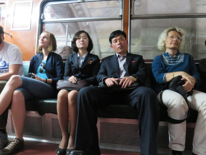 A photo taken while riding the Pyongyang metro. The two North Koreans are flanked by my fellow tourists of our tour group (19 of us).
