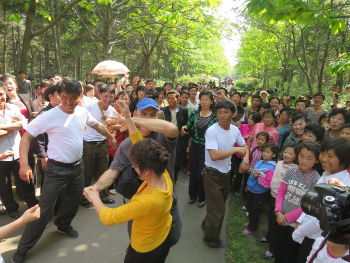 Dancing with the locals in a park in Pyongyang. It was a national holiday (May 1).