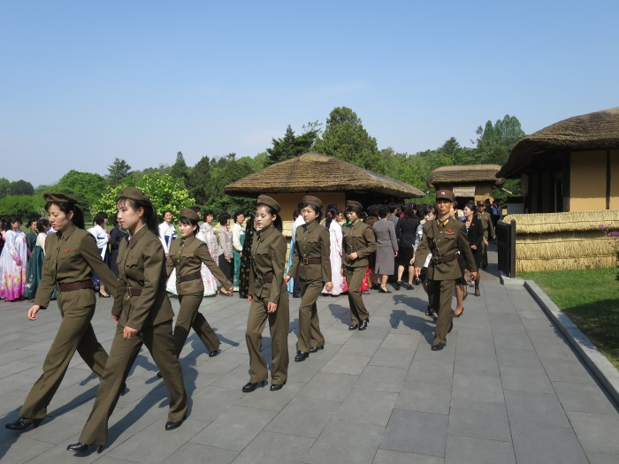 Women in military uniform - not an uncommon sight - at a tourist location.
