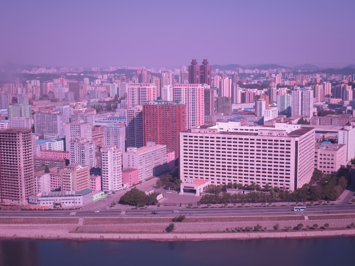 The view from my hotel (floor 39, room 19)  at the Yanggakdo International Hotel, in the capital Pyongyang. The colour tint is due to the fact I used my sunglasses as a filter for my camera to cut down on the haze.