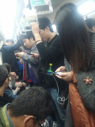 The blasted subway. Cheap, convenient and horrible. I spend time using this to get to social and professional destinations. What's unique about Beijing's subway is that you'll get these salt-of-the-earth rural migrants with their rag bundles mixing up with neatly attired office ladies. All crushed together.