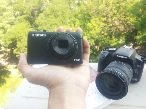 My Canon Powershot S120, and Canon 450D DSLR; the photo was taken with my crummy mobile phone camera.
